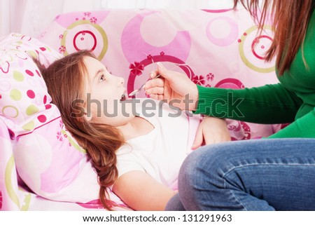 ill girl with mother - stock photo