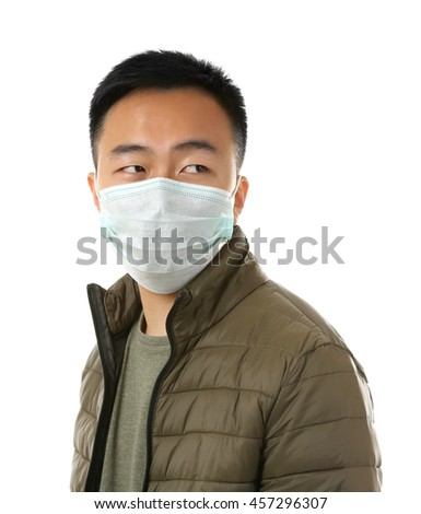 Ill man wearing mask isolated on white - stock photo