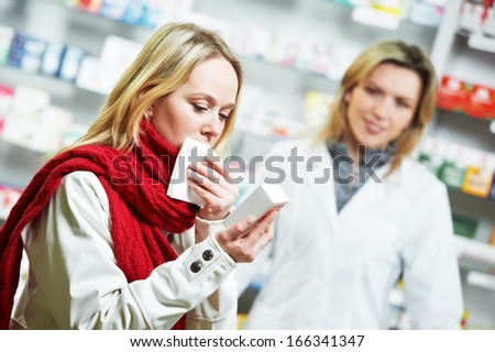 ill purchaser with medical drug in pharmacy drugstore - stock photo
