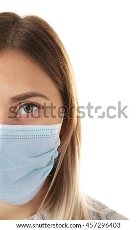 Ill woman wearing mask isolated on white, close up - stock photo