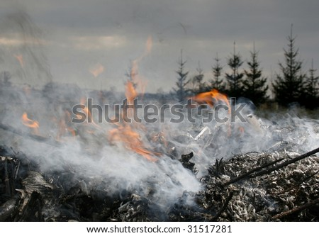 illegal burn refuse, poisonous smoke, fire and fumes, clouds of toxic smoke - stock photo