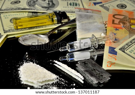Illegal drugs on the streets of money - stock photo