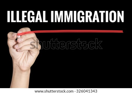 Illegal Immigration word writting by men hand holding highlighter pen with line on black background - stock photo
