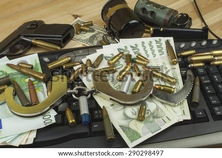 Illegal trade in arms over the internet. Real money EU and the Czech koruna. Illegal trade of ammunition. Detection and arrest of arms dealers. - stock photo