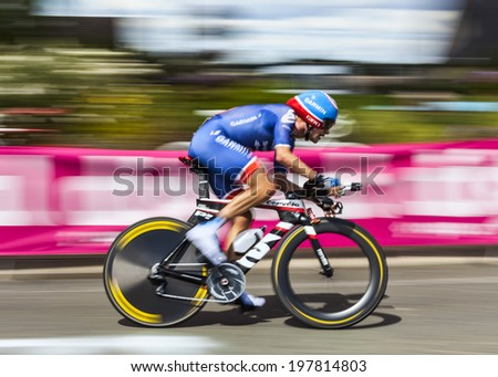 ILLIERS COMBRAY,FRANCE,JUL 2:Paning image of the German cyclist David Zabriskie (Team Garmin Sharp) riding during the 19 stage- a time trial between Bonneval and Chartres on July 21 2012. - stock photo