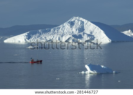 ILLULISAT/GREENLAND - AUGUST 2007 - Giant Icebergs of Disko Bay near Illulisat, Greenland, a popular cruise destination - stock photo