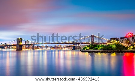 Illuminated Brooklyn Bridge at dusk viewed from Pier2 park in New Yok City - stock photo