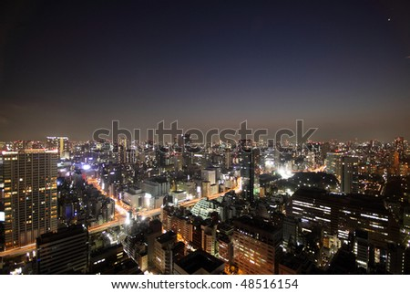 Illuminated buildings and road during sunset in Tokyo, Japan - stock photo