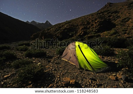 Illuminated Camping tent at Night in the mountain - stock photo
