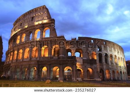 illuminated Colosseum at twilight, Italy - stock photo