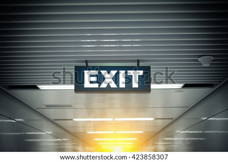 Illuminated Corporate Office Exit Sign in modern  - stock photo