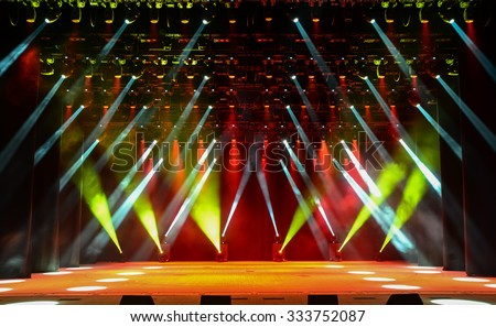 Illuminated empty concert stage with smoke - stock photo