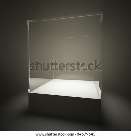 Illuminated empty glass showcase in room - stock photo