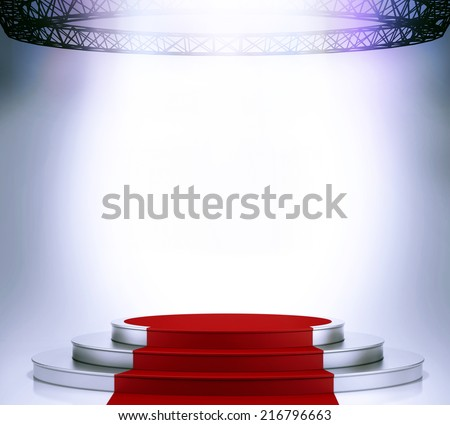 Illuminated empty stage podium with red carpet for award ceremony  - stock photo