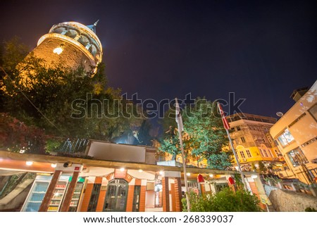 Illuminated Galata Tower in Istanbul, Turkey - stock photo