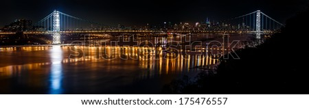 Illuminated George Washington Bridge above a frozen Hudson river with the Manhattan skyline in the background (51Mpx) - stock photo