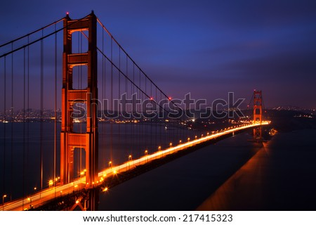 Illuminated Golden Gate Bridge at dusk, San Francisco - stock photo
