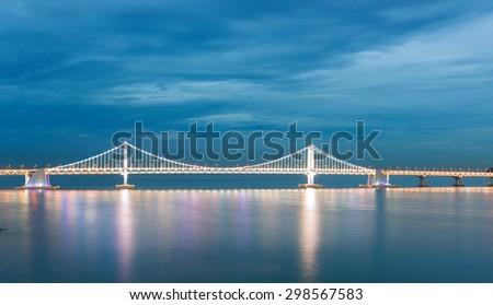 Illuminated Gwangalli Bridge in the late evening time. Busan, South Korea. - stock photo