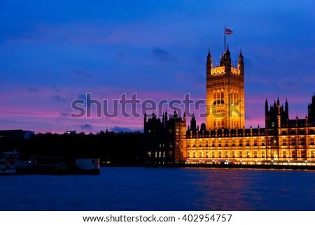 Illuminated Houses of Parliament at dusk - stock photo