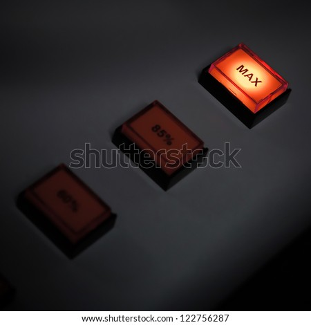 Illuminated max button on industrial power control panel. Selective focus - stock photo
