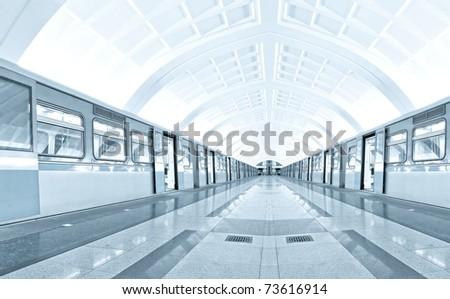 illuminated metro station with marble floor - stock photo