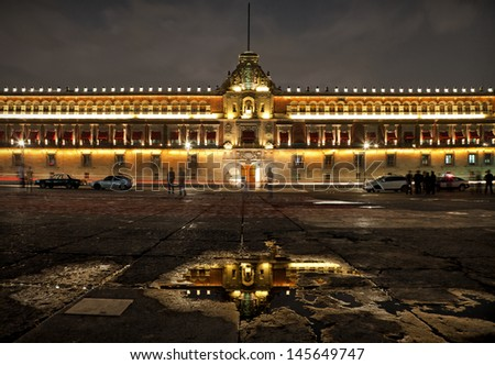Illuminated National Palace in Plaza de la Constitucion of Mexico City at Night. Zocalo and Army Square are among other local names of this place. - stock photo