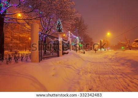 Illuminated Night Winter City Scene - stock photo