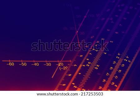 Illuminated numbers and graphic on dark background - stock photo