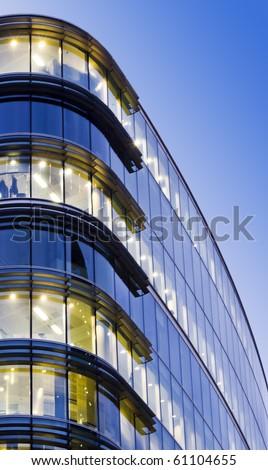 Illuminated Office Building at twilight, London - stock photo