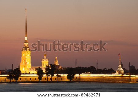 Illuminated Peter and Paul fortress at sunset, St Petersburg, Russia - stock photo