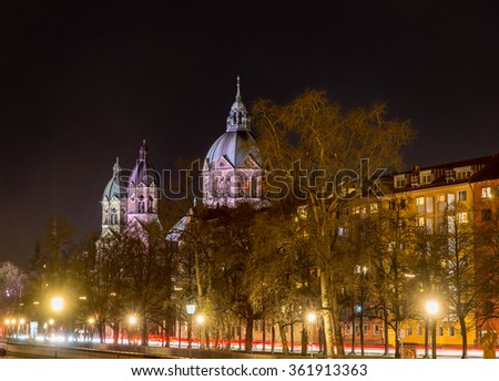 Illuminated Sankt Lukas church in Munich at night - stock photo