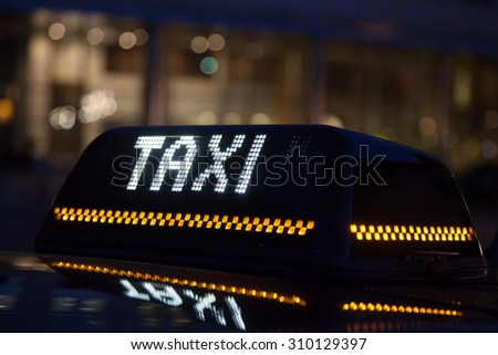 Illuminated sign of a black cab in the city of Brussels, Belgium - stock photo