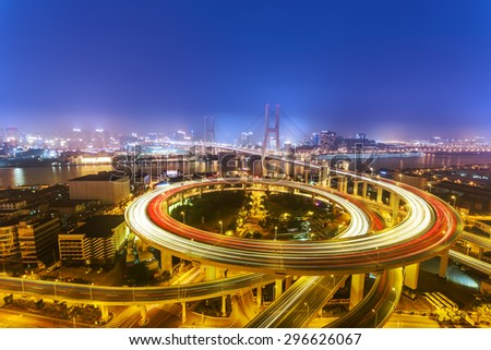 Illuminated skyline and road intersection in shanghai - stock photo