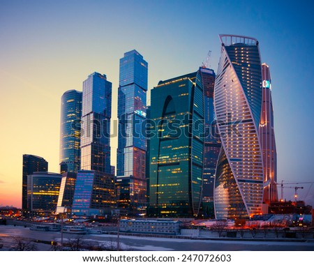Illuminated Skyscrapers Buildings of Moscow City business complex at dusk, Moscow, Russia. - stock photo