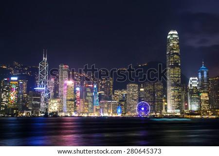 illuminated skyscrapers in victoria harbor,hongkong. - stock photo