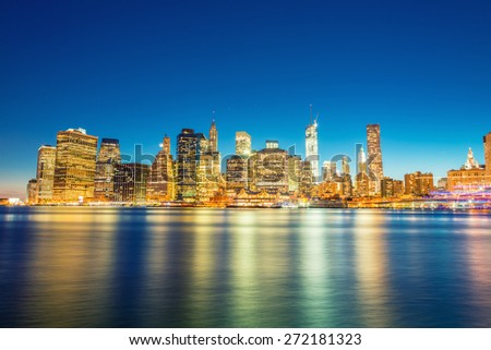 Illuminated skyscrapers of Downtown Manhattan at dusk. - stock photo