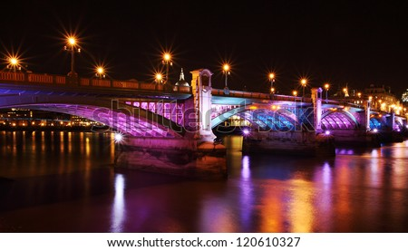 illuminated southwark bridge at night - stock photo
