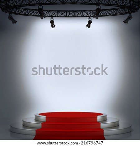 Illuminated stage podium with red carpet for award ceremony  - stock photo