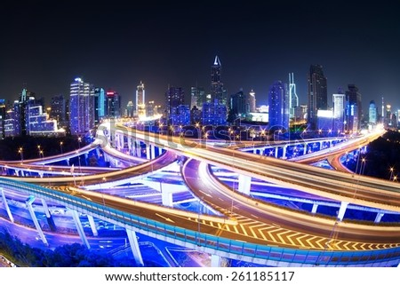 illuminated traffic on elevated expressway in modern city - stock photo