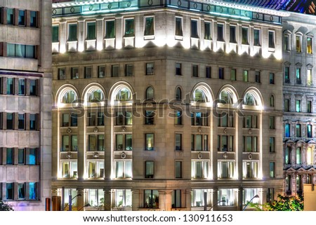 Illuminated Windows of the office buildings of Old Montreal. (HDR image) - stock photo