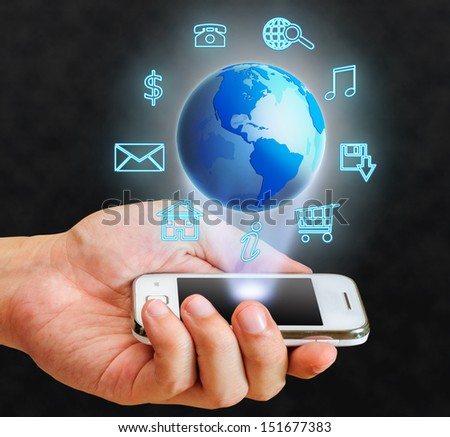 illustration blue globe floating from smart phone and internet useful in dark tone - stock photo