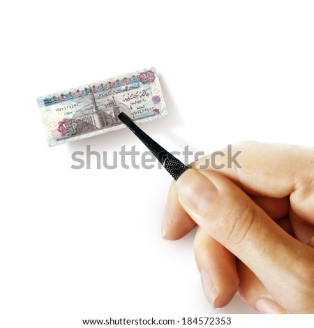 Illustration for inflation - hand with a pincer holding small banknote of Egyptian pound, white background - stock photo