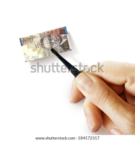 Illustration for inflation - hand with a pincer holding small banknote of Israeli shekel, white background - stock photo