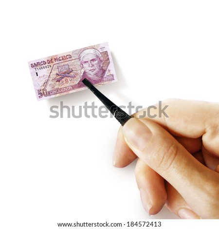 Illustration for inflation - hand with a pincer holding small banknote of Mexican peso, white background - stock photo