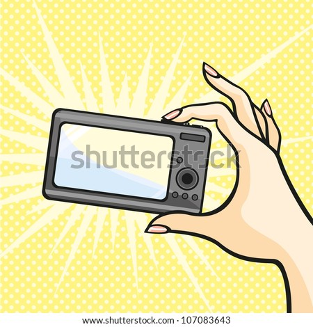 Illustration of a female hand holding a photo camera (raster version) - stock photo