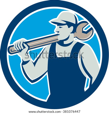 Illustration of a mechanic holding spanner on shoulder looking to the side set inside circle on isolated background done in retro style.  - stock photo