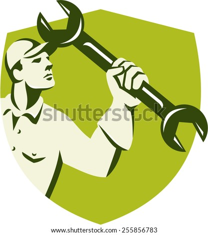 Illustration of a mechanic wielding holding spanner wrench looking up viewed from side set inside shield crest on isolated background done in retro style.  - stock photo