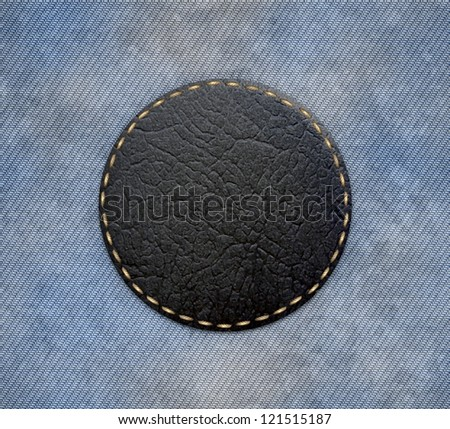 Illustration of a patch stitched to a denim background - stock photo