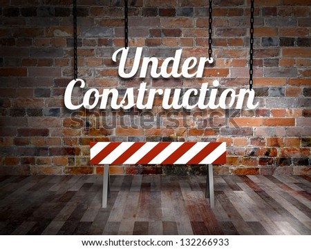 Illustration of a under construction sign hanging from chains - stock photo