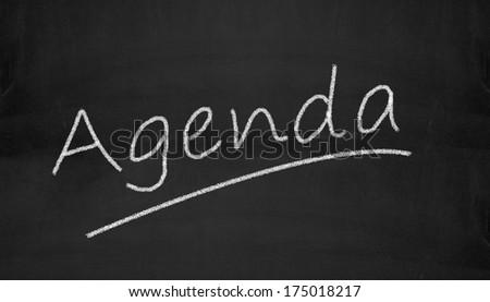 Illustration of agenda written on black chalkboard - stock photo